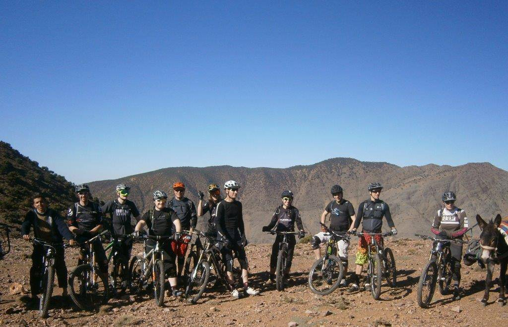 photo of a group of riders on a mountainside